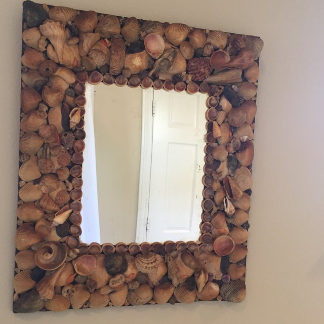 Vintage mirror with frame made of seashells.