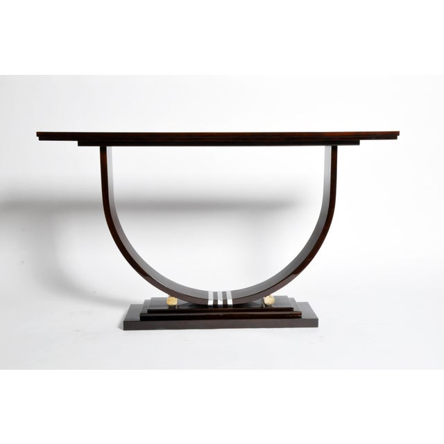 Stunning Mid-Century style console with dark walnut veneer and chrome accents. This piece imparts a chic, architectural...