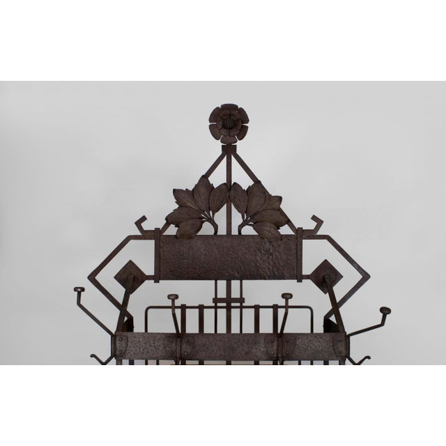 "French Art Deco (possibly Austrian) iron hatrack/umbrella stand with a shelf and a filigree ""bat"" design base with a..."