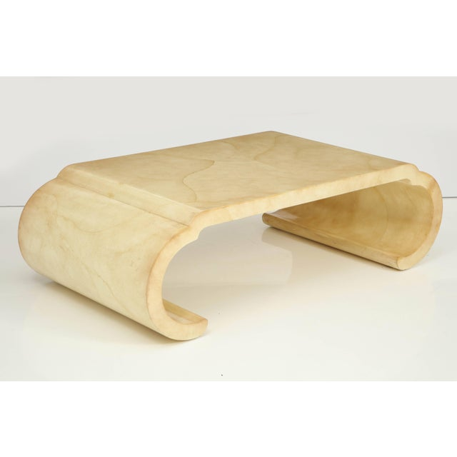 This chic piece is not only a functional coffee table, but an exceptional work of art. Its curved shape is Asian...