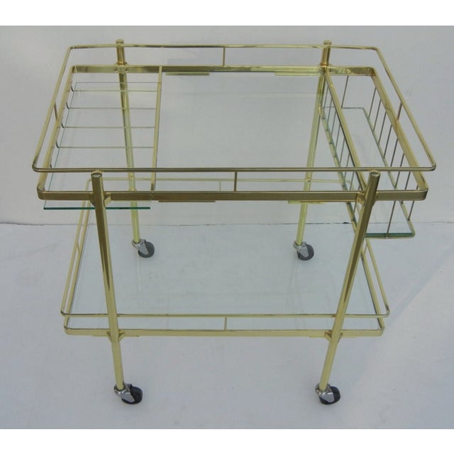 A really great Italian brass bar cart that has been professionally polished and lacquered.
