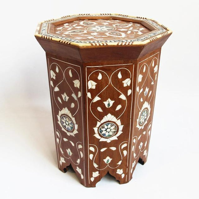 Intricate abalone shell, bone, and mother of pearl inlay teak side table.