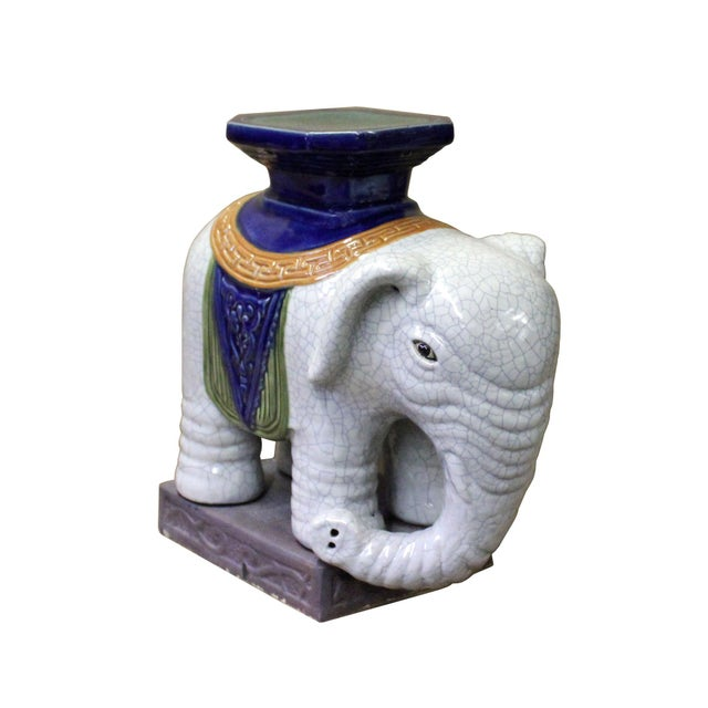This is a traditional Chinese decorative elephant figure made of ceramic and glazed with off-white color with crackle...