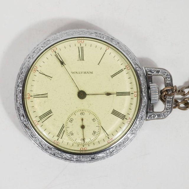 This classic chronometer pocket watch features delicate reed shaped hour and minutes hands on the main dial, roman...