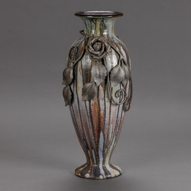 Circa 1930s tall vase by Belgian artist Roger Guerin in streaky blue gray glaze with beautifully detailed iron overlay of...