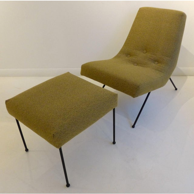 Low-slung and sexy lounge chair with ottoman, an early work by Adrian Pearsall for his Craft Associates company. In a...