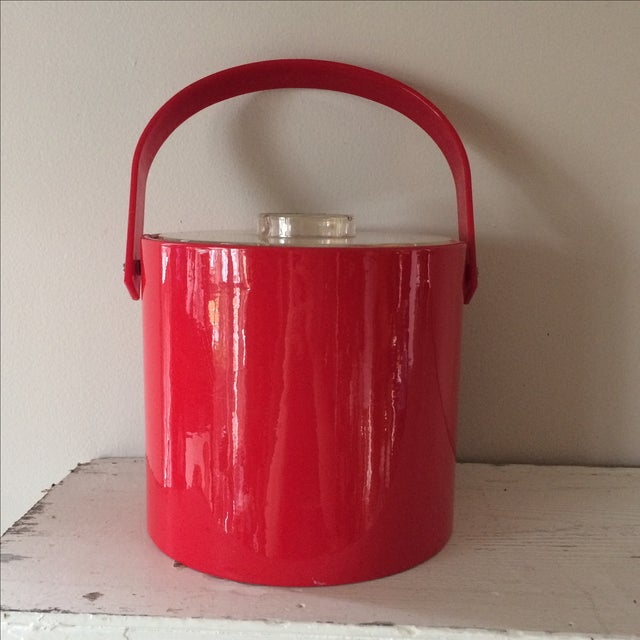Perfect for entertaining. Mid-Century Modern style ice bucket in a beautiful red. Excellent condition. Lid and tongs...