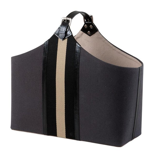 Dark gray bag which is perfect for storing magazines and other accessories. With leather buckle handle it has contrasting...