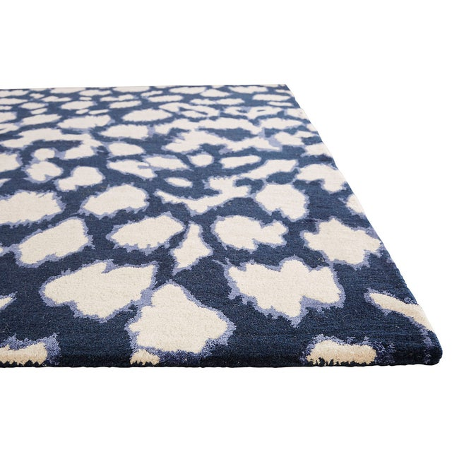 A contemporary take on animal print, this dark navy wool and silk hand-tufted rug gives any room a bit of a refined wild...