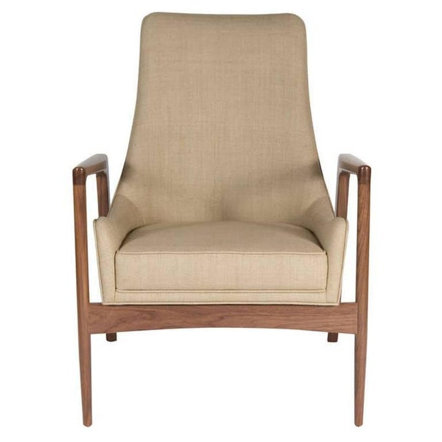 Solid walnut sculpted arm club chair. Sculptural profile upholstered one-piece construction that is integrated within the...