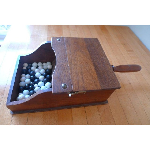 Image result for images of black & white ballot box balls