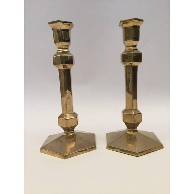 Pair of brass polished candlesticks with a molded hexagonal base. Nice elegant forms with original patina. Great brass...