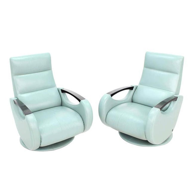 Pair of space age Mid-Century modern swivel lounge space age chairs recliners.