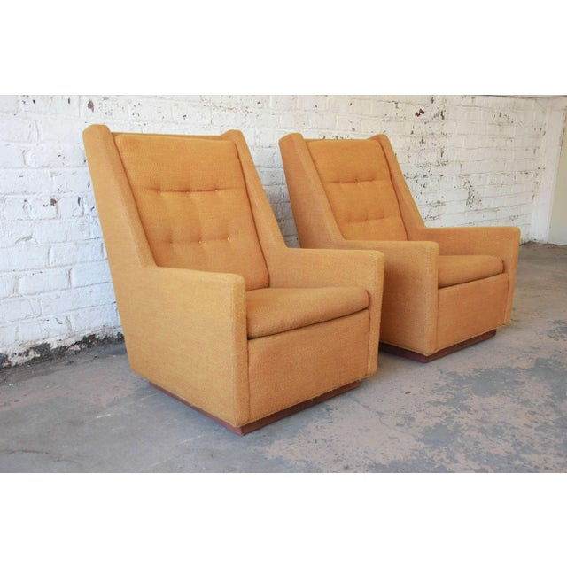 Offering an original pair of mid-century modern lounge chairs and ottoman by Milo Baughman for James, Inc. The chairs have...