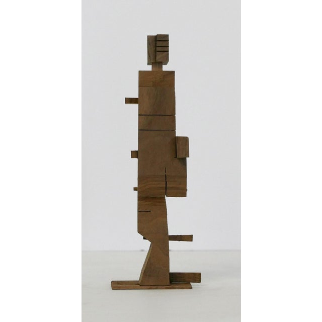 Small unstained walnut architectural sculpture by Los Angeles artist, Behzad Haghiri. Each sculpture is unique. He makes...