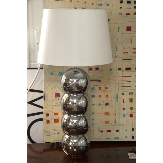 A fine pair of the classic 1960s chrome ball lamps designed and manufactured by George Kovacs. Excellent condition, the...