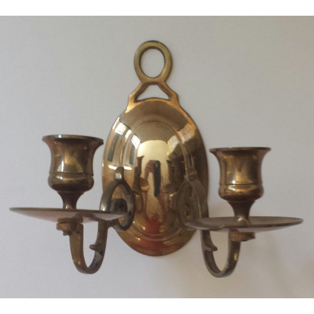 We love this unique brass 2 candle sconce because it holds two candles abd the exterior is conditioned with years of...