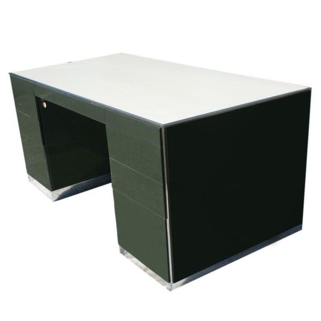 A mid cneutry modern desk and credenza designed by Davis Allen and made by GF. Green metal with chrome bases and accents...