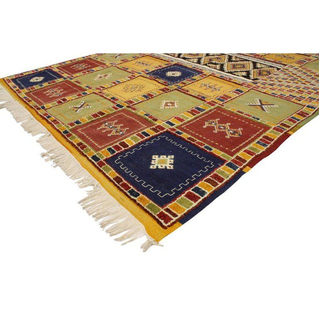 This Berber Moroccan Kilim rug with high-low pile features a tribal style, yet it still reflects an understated appearance...