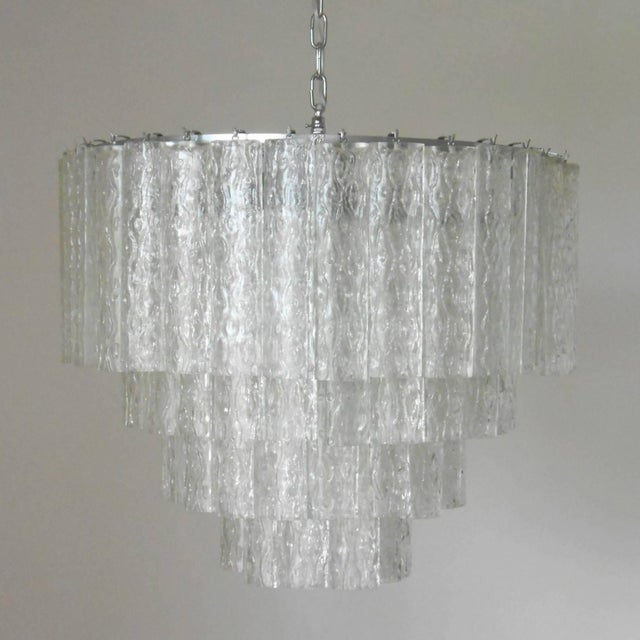 Vintage Italian chandelier with clear Murano glass tubes blown into beautiful oval shapes with textured designs, mounted...