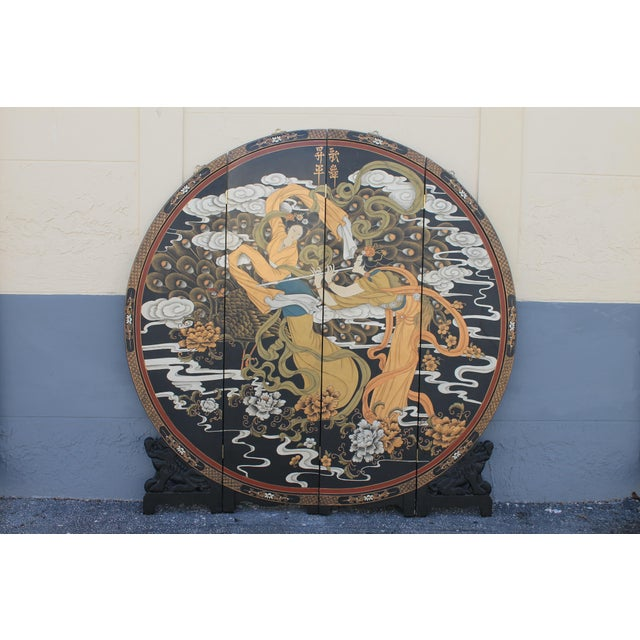 A stunning oriental circular room dividing screen, carved wood base, circular main 4 panelled screen/ heavy. Highly...