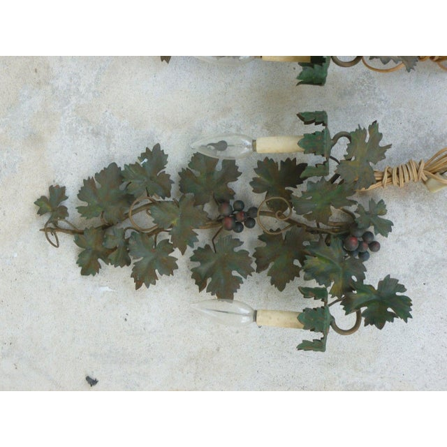 Pair of Mid Century Italian tole sconces of grapes and vines sold as found in original estate bought condition .