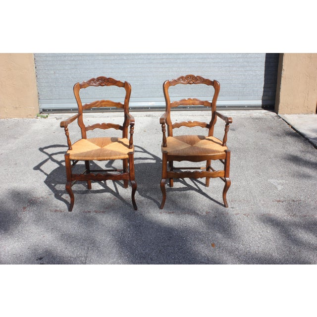 Pair of Fine French country rush seat solid walnut bergere chairs circa 1910s. The pair of French country ladder back...