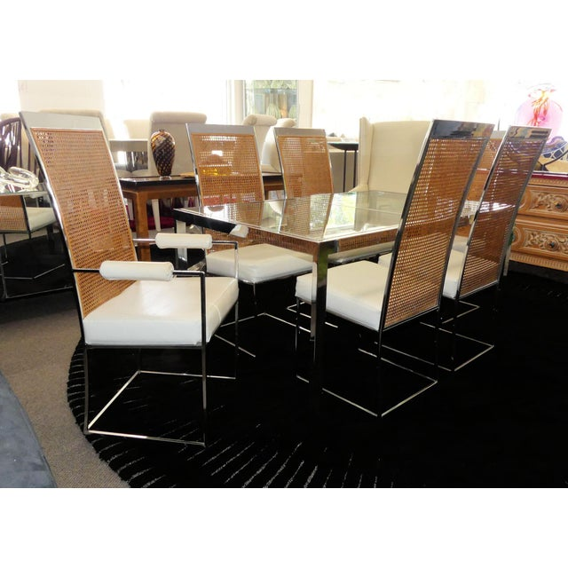 Mid-century modern dining set designed by Milo Baughman and manufactured by Thayer Coggin in 1976. Chromed steel dining...