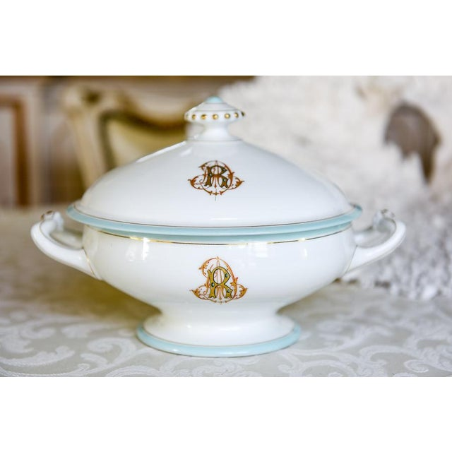 Such a pretty antique French porcelain tureen with beautiful monograms on the base and lid! Can't decipher the monogram,...