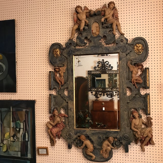 Hand made and hand painted alabaster mirror. Features ornate alabaster frame adorned with women and children angels seated...