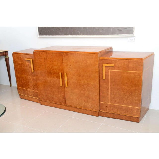 The rectangular top with stepped sides over four doors with line inlay. signed Eli Jacques Kahn provenance, Ettinger...