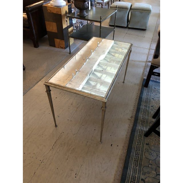 Truly elegant silver leafed coffee table with an antiques mirror surface. The table is constructed of silver leafed steel;...