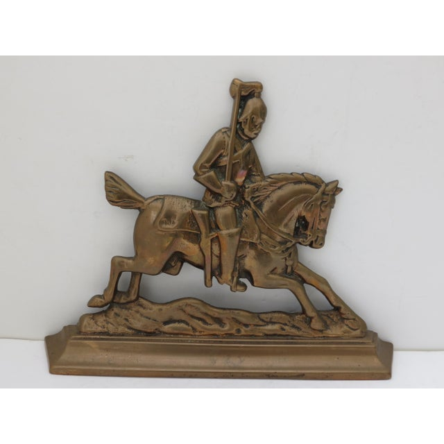 A solid brass knight on a horse fireplace ornament or doorstop. A stately piece that will compliment any room.