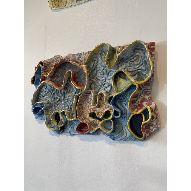 Wall art porcelain and glass sculpture by Chicago artist Nancy VanKanegan.