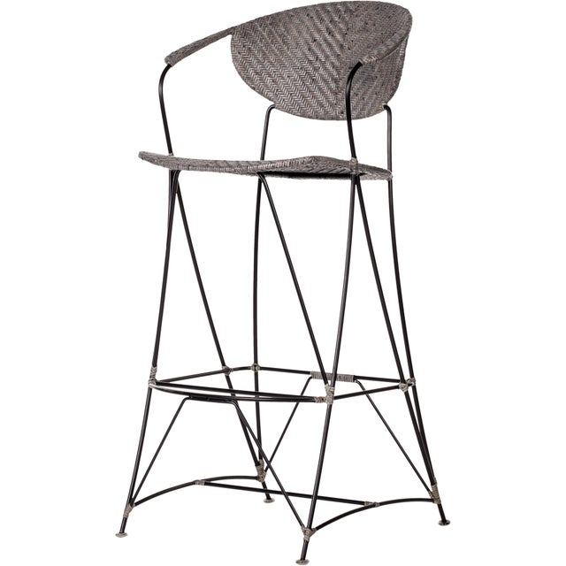 These David Francis bar height barstools feature a powder-coated steel frame wrapped with woven cane in a Herringbone...
