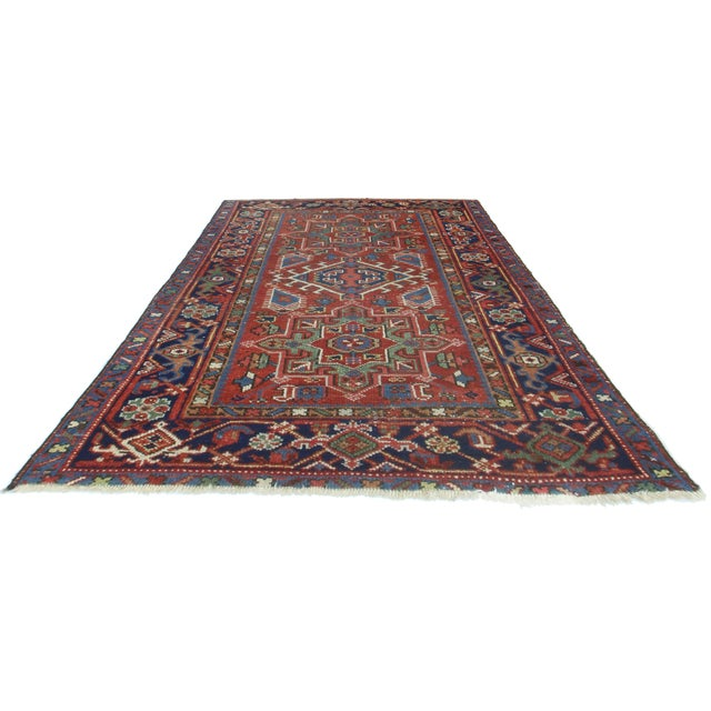 This hand-knotted wool Persian Karajeh rug features a versatile medallion design.
