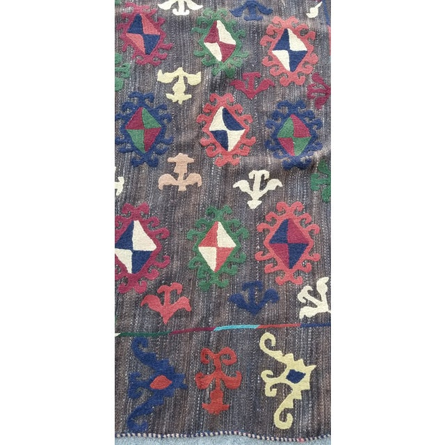 A beautiful new wool rug. Thickly woven by hand from local sheepswool nd decorated with a hand embroidered design. Made by...