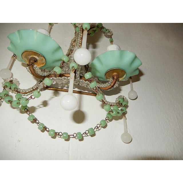 Housing two lights each. Rewired and ready to hang. Rare sea foam green ribbon cups and matching beads. Also adorning...
