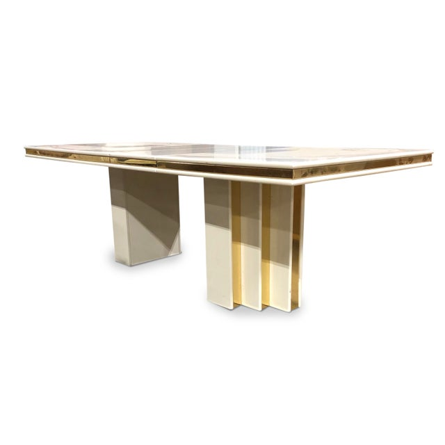 Wonderful vintage white lacquered table with brass inlays designed by Roger Rougier. Looks elegant, polished and very...