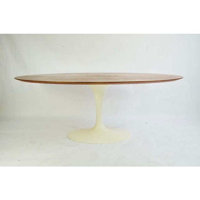 Vintage Eero Saarinen for Knoll Walnut Oval Dining Table. Heavy cast base. Table top is Currently being refinished in the...