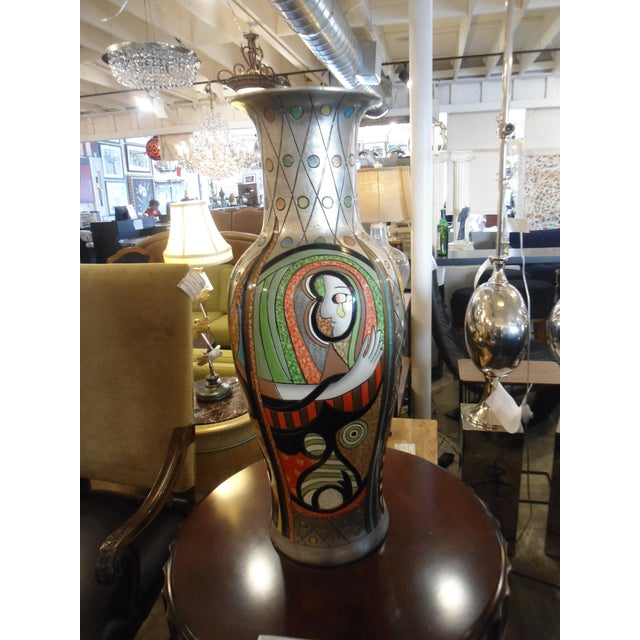 "This is a beautiful and unique vase inspired by the Picasso piece ""Girl Before a Mirror"". There is a multitude of..."