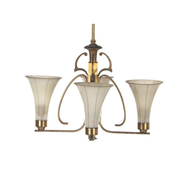 Art Deco ceiling lamp with a patinated brass frame, trumpet-shaped striped glass shades. Manufactured in Denmark in the...