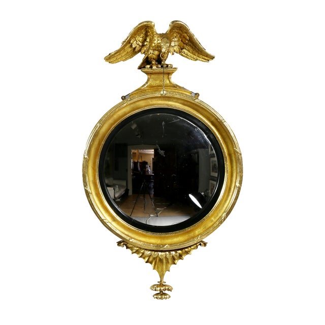 Each with eagle finials over a convex plate with ebonized conforming ring and conforming frame , shaped leaf base....