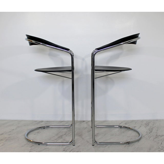 For your consideration is a fantastic pair of bar stools, made of chrome and with angular black vinyl, made in Italy by...