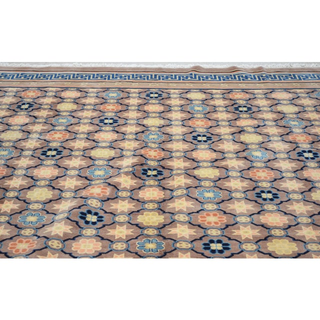 Antique Chinese Art Deco hand knotted rug with natural colors and unique pattern.