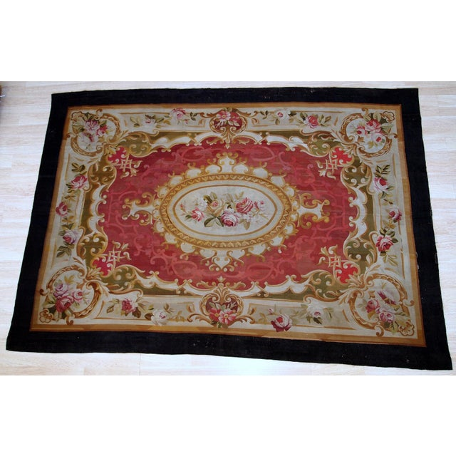 Antique handmade French Abussan rug in red, beige and olive shades. This flat-weave is from the middle of 19th century in...