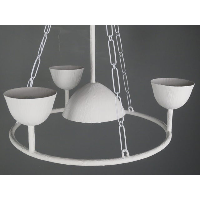 Circle of 4 Cups Plaster and steel chandelier with a white enamel finish. May include ball, ceiling cap along with...