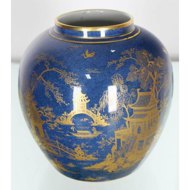Very nice cobalt blue gold painted decorated globe shape vase. Measures: 8 inches tall.