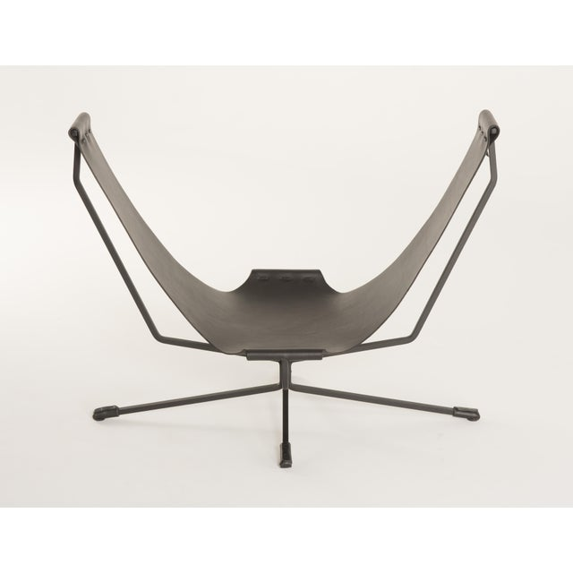A unique chair for reading and lounging. Rest your back against one side and your legs against the opposite side. Latigo...
