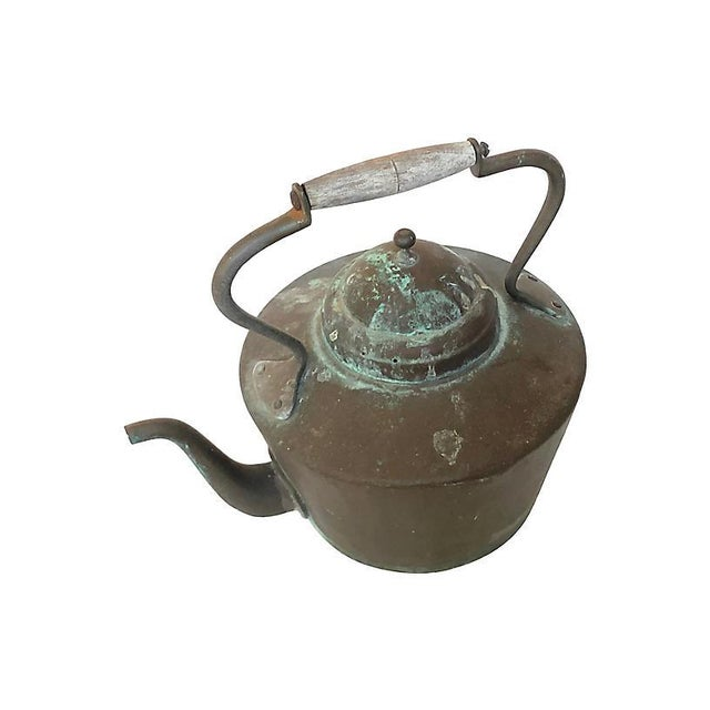 Primitive French copper kettle with wooden handle. Desirable verdigris patina throughout, reinforced with rivets. Age...